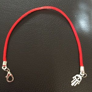 Red string protection bracelet with amulet
