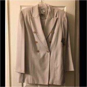 Jacqueline Ferrar's Grey Suit