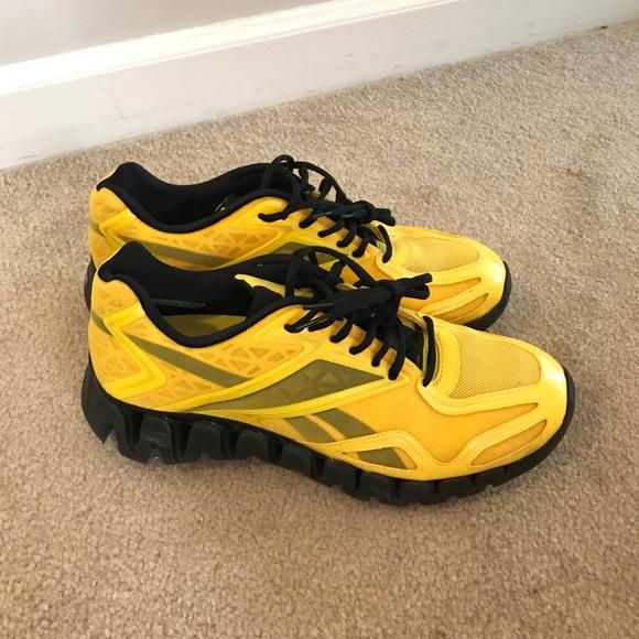 best loved c49bc 37288 Reebok ZigSonic Men s Running Shoes - Yellow Black.  M 5831e872f739bc8b2607bbb3