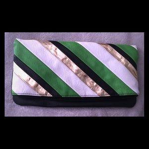 Black white gold and green stripe foldover clutch