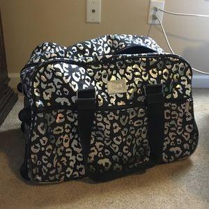 Victoria secret rolling duffle bag