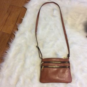 Cross body brown purse.