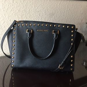 Jet black, studded Michael Kors handbag