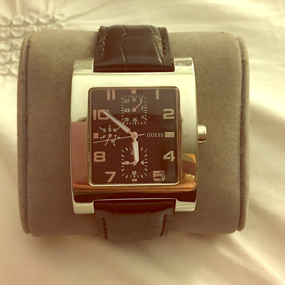 709fd8fed33 Guess watch silver square face black leather band