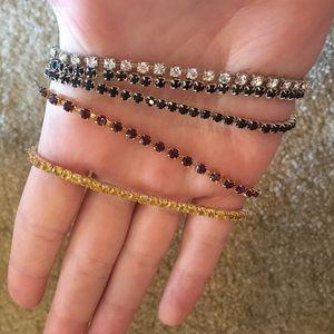 Set of 5 bracelets. One is Avon