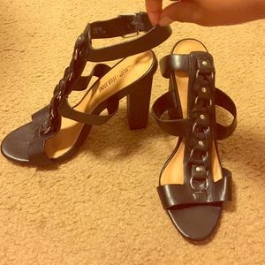 Strappy heels with ankle buckle.