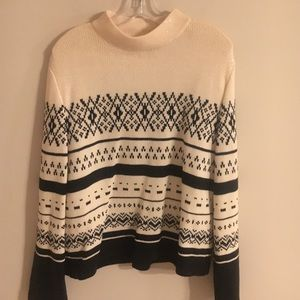 St. John cream sweater with sparking piates.