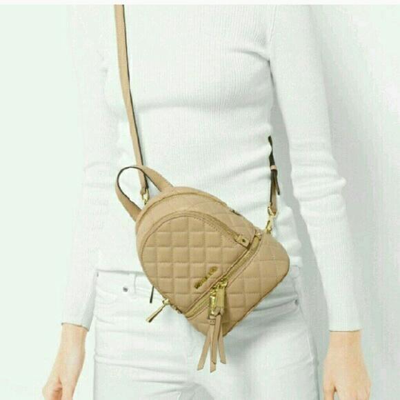 0382e504e443 Michael Kors backpack crossbody purse