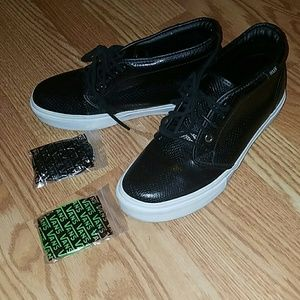 vans high tops black on feet