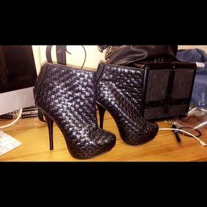 Black leather booty heel (size 6.5)