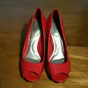 Vixen red open-toe pumps.