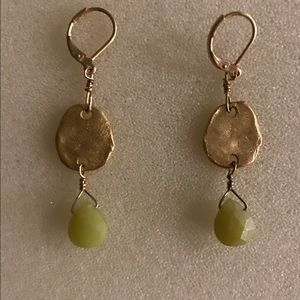 Earrings-gold tone with green faceted stone