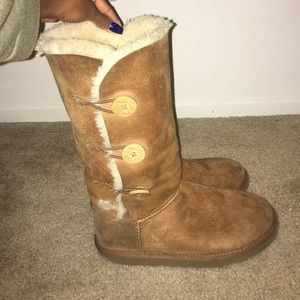 Brown chestnut button up tall ugg boots.