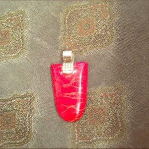 Red stone pendant.