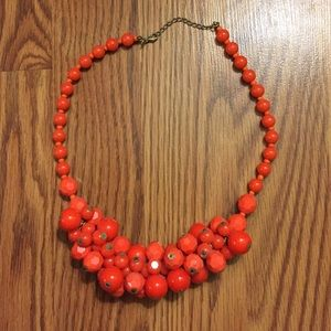 Orange and coral beaded chunky statement necklace.