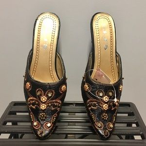 Unique mules with stitching and beaded details