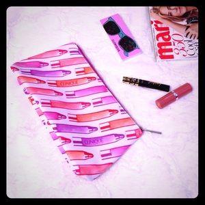 Clinique Handbags - CLINIQUE Pink Makeup Print Cosmetic Bag