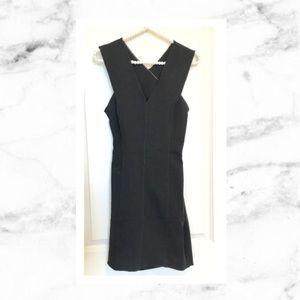 bebe Dresses & Skirts - Bebe Ponte Crossback Dress in Black