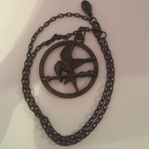 Hot Topic Jewelry - Hunger Games Mockingjay necklace