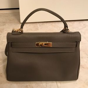 Taupe color bag with gold hardware