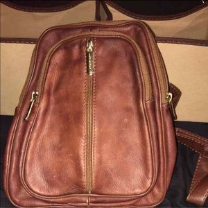 Leather sling pack, used for sale