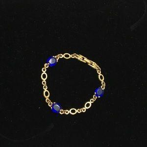 Nina Ricci Jewelry - Vintage Nina Ricci gold and blue stone bracelet