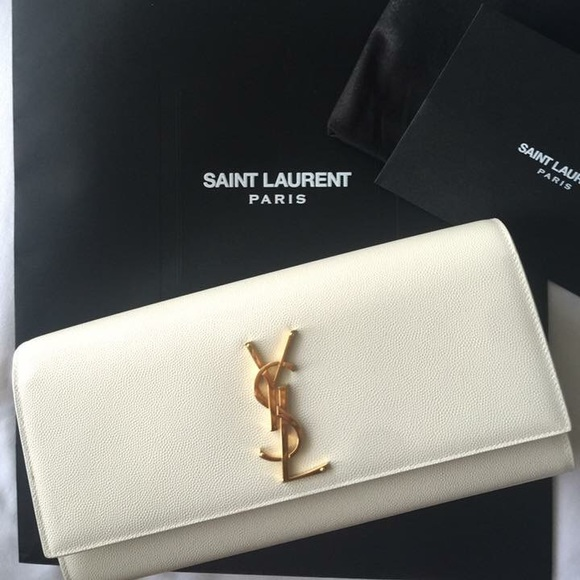 YSL off white monogram clutch. M 584201ea620ff7d28500597f. Other Bags you  may like. Authentic Saint Laurent ... b385d7b0003ba