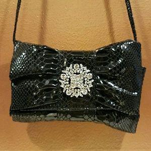 Black Iman clutch