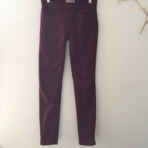 Madewell skinny jeans in dark cabernet red, 24
