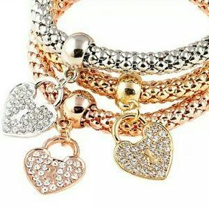 Jewelry - 3 bracelets w/heart locks: silver, gold, rose gold