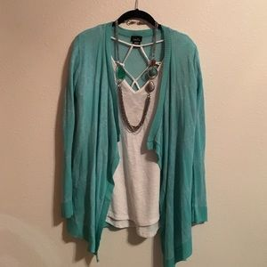 Mint green and white cardigan sweater