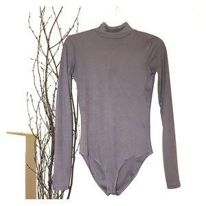 Zara Tops - Long sleeve bodysuit by ZARA