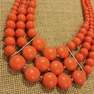 A coral orange statement necklace