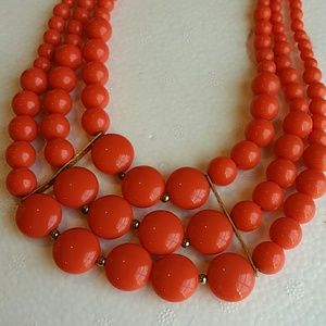 A coral orange statement necklace