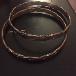 One of two vintage flat metal bangles from 1970s