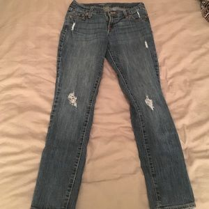 Petite worn out skinny jeans