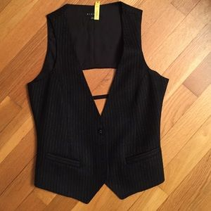 SEXY woman's vest. Check out open back.
