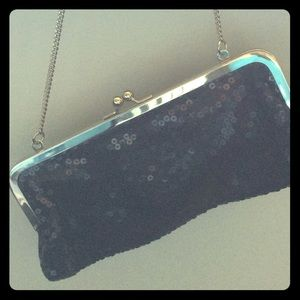 NWOT sequined black clutch with metal strap