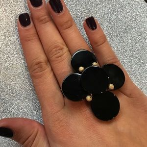 Black shinny stone cross shaped ring