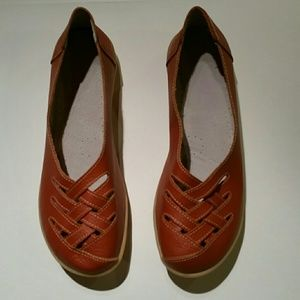 Slip on burnt orange cut out leather loafers