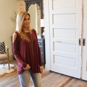 Open shoulder long sleeve tunic in red-brown