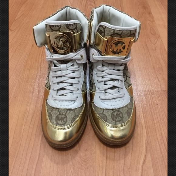 Michael Kors Shoes   Nikko Hidden Wedge Gold Sneakers   Poshmark 25d60402b77