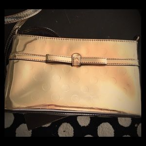Gently used auth Kate Spade crossbody gold bag