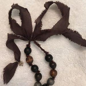 Beautiful silk metallic bead necklace layer or not