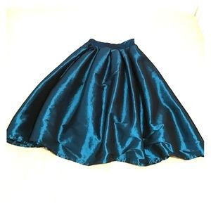 Blue full taffeta like skirt.