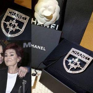 CHANEL Jewelry - CHANEL CC LOGO CRYSTAL SILVER SHIELD CREST BROOCH