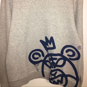 Grey crew neck Mishka sweater.