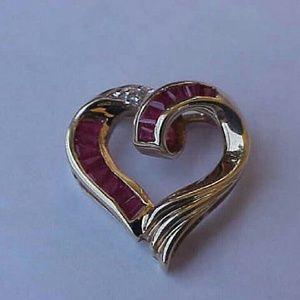 Other - 10k gold .50ct genuine Diamonds & Rubies pendant