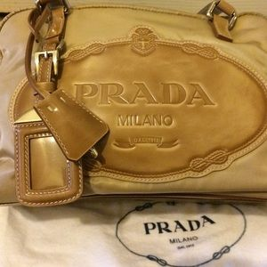 Prada Handbags - Prada retired beige & tan handbag w/lock & Keys
