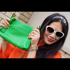 Michael Kors Handbags - Michael Kors green tassel leather cross body bag